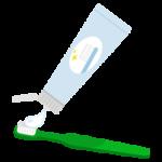 緑の歯ブラシに歯磨き粉をつけるイラスト
